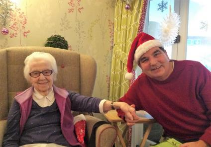 Mill House Care Home, Oxfordshire. 11th December, carols with our friends from the Methodist Church. Sheila and David enjoying the festive community spirit