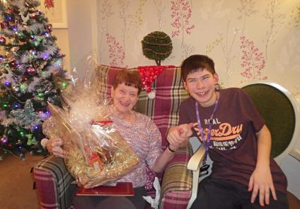 Mill House Care Home, Oxfordshire. Christmas Bingo with our friends from Abingdon and Witney College. Resident Mavis won a lovely hamper from the students for getting a full house!
