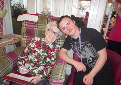 Mill House Care Home, Oxfordshire. Christmas Bingo with our friends from Abingdon and Witney College. Resident Sheila enjoying the game with one of the students