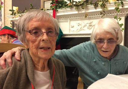 Ross Court Care Home, Herefordshire. Residents Mary and Gladwys awaiting the arrival of Santa to our Christmas party
