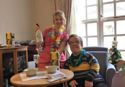 Springfield House Care Home, Staffordshire. We decided to have our Boxing Day 'at the beach' and enjoyed tropical cocktails! Team member Laura and resident Robert mixing up some Pina Coladas