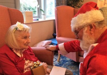 The Cedars Care Home, Salisbury. Resident Bessie receiving a gift from Father Christmas