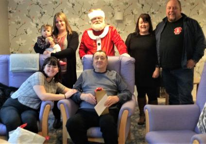 The Cedars Care Home, Salisbury. Resident William Pearce and his family with the big man in red on Christmas Day