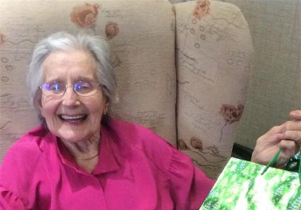 Westbury Court Care Home, Wiltshire. Resident Jean Argent was delighted to receive a present from Father Christmas