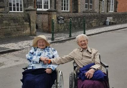 Broadway Halls Care Home, Dudley- Residents Lil and Doreen outside the old school