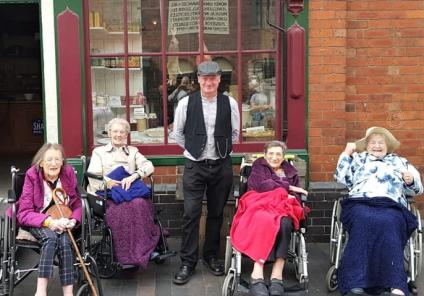 Broadway Halls Care Home, Dudley- Residents Shirley, Doreen, Mollie and Lil with one of the museum team