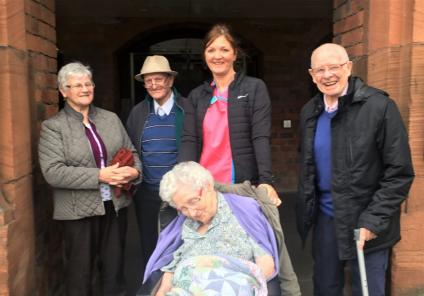 Buchanan House Care Home, Glasgow-Residents Margaret, Christopher, Isobel and Alec with Magic Moments Club Coordinator Geraldine at the entrance to Kelvingrove Galleries