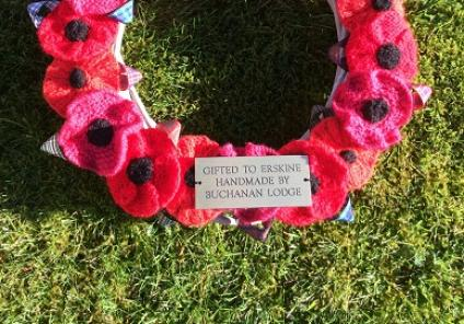 A close up of the wonderful wreath with its knitted poppies