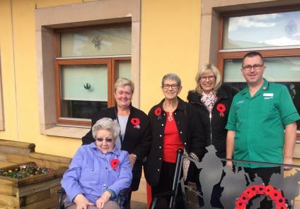 Resident Margaret with team members Frances, Irene, and Allison and Erskine's Craig Berry