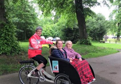 Buchanan Lodge Care Home, Glasgow-Magic Moments Club Coordinator Holly and resident Isobel are ready for their ride around Callendar Park