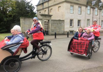 Buchanan Lodge Care Home, Glasgow-Residents Flora and Betty, team member Holly and resident Isobel outside Callendar House