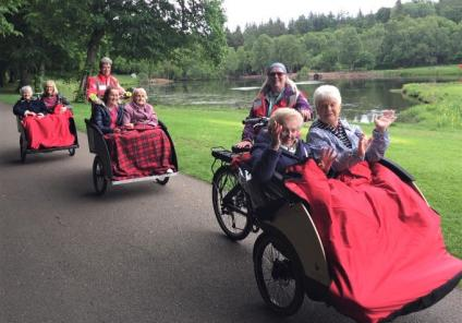 Buchanan Lodge Care Home, Glasgow-Team member Allison, resident Helen, team member Holly, residents Isobel, Flora and Betty and our Cycling without Age volunteers