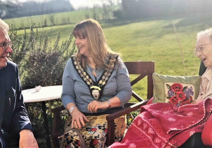 Hungerford Care Home in Berkshire had an 'International Mystery Food Festival'. Deputy Mayor Keith Knight and Mayor Helen Simpson having a natter with resident June.