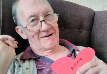 Carlton Mansions Care Home, Bristol. Resident Peter shows his appreciation for Care Assistant Annie