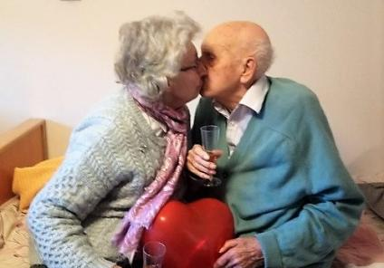 Crabwall Hall Care Home, Cheshire. Joan and her husband, resident Dennis, share a Valentine's kiss