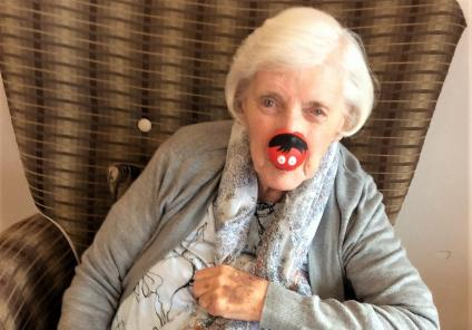 Crabwall Hall Care Home, Cheshire. Resident Betty sporting her red nose for Comic Relief