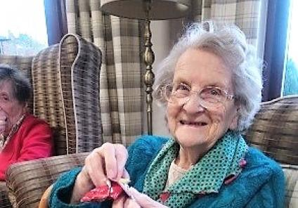 Crabwall Hall Care Home, Chester. Resident Christine opening her fortune cookie