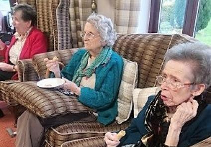 Crabwall Hall Care Home, Chester. Residents Mary, Christine and Gill having a go at pronouncing a sentence in Chinese