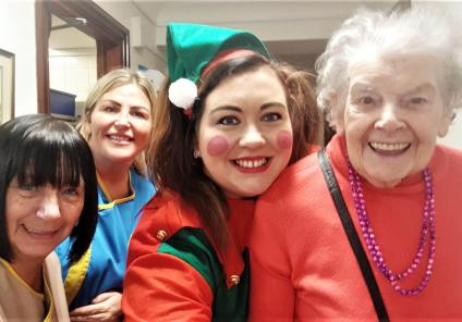 Crabwall Hall's elf (Home Manager Kirsty Jones) putting a smile on everybody's faces! With resident Vera and team members June and Lisa