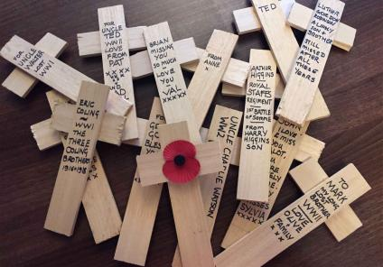wooden crosses were used by residents to write their own personal dedications on the reverse