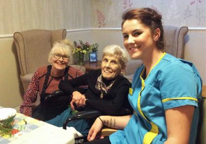 Karen, resident Joce and Carer Leighan enjoying the festive afternoon
