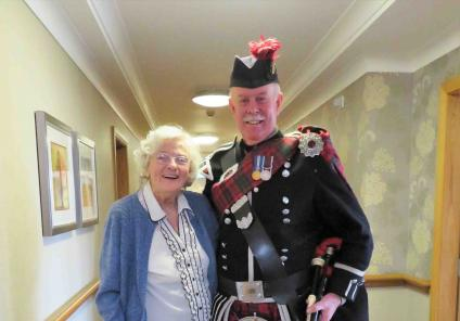 Westbury Court Care Home had a special performance from bagpipe player  Bob MacNaught. Here he is with resident Eileen