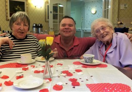 Elm Bank Care Home, Northamptonshire. Resident Lottie, Magic Moments Club Assistant Mark and resident Doris enjoying our Valentine's coffee morning