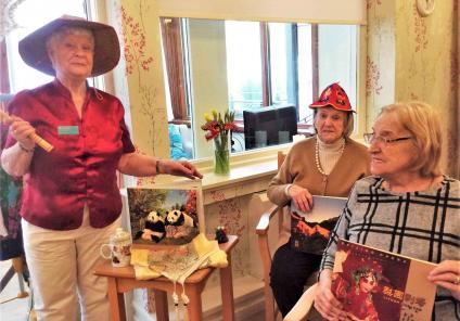 Buchanan Lodge Care Home, Glasgow. Our Activities Volunteer, Flora gave a fascinating presentation about her trip to China. Residents Joan and Rita take a closer look at the interesting colourful items Flora brought back from the trip
