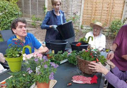 Residents at The Wimborne Care Home in Dorset are green-fingered out in the garden for Naturewatch