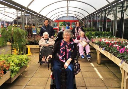 Residents Betty, Pat and Doreen enjoy the day with Care Assistant Kumar and Magic Moments Club Co-ordinator Katie