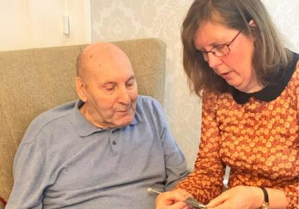 Hamilton House Care Home, Buckingham-Resident Edward learning to knit as Janet shows him the ropes