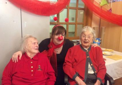 Henleigh Hall Care Home, Sheffield. Resident Elizabeth, team member Kate and resident Hilda having fun together on Red Nose Day