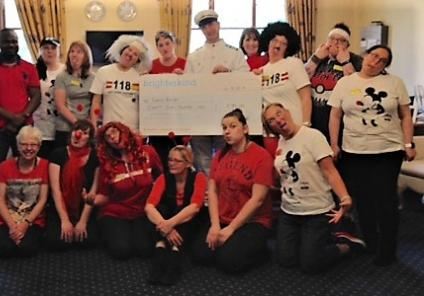 Henleigh Hall Care Home, Sheffield. Team members all dressed up for Red Nose Day with our cheque for £85 for Comic Relief
