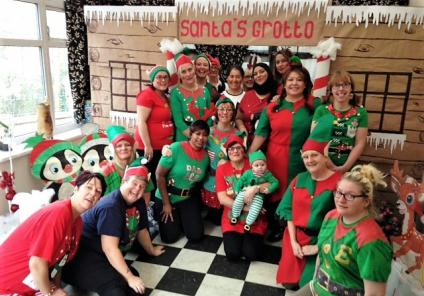 Henleigh Hall's team of elves gather around Santa's Grotto!