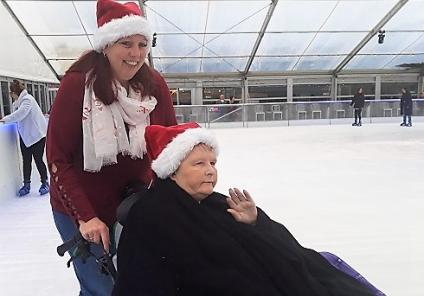 Carer Penny and resident Mary take a spin around the ice rink