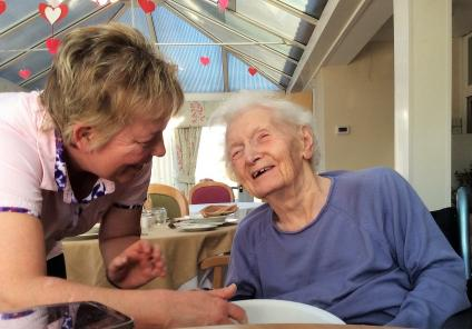 Highfields Care Home, Newark. Chef Christine and resident Betty having fun making Valentine's biscuits