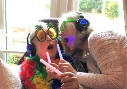 Hungerford Care Home, Berkshire-Resident Sylvia and Senior Carer Sue enjoying singing to Abba