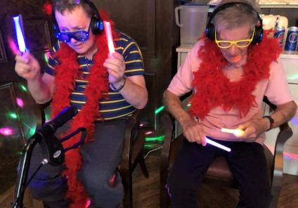 Hungerford Care Home, Berkshire-Residents Graham and Roger using light wands as drumsticks!