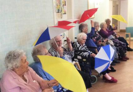 "Residents are ""Singin' in the rain"" as they dance with their brollies!"