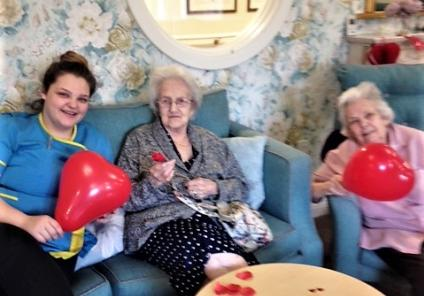 Bamfield Lodge Care Home in Bristol are enjoying some crafts this Valentine's! Care assistant Ella making paper roses with residents Jean and June.
