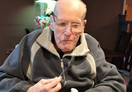 Ivybank House Care Home, Bath-Ken tucking into his favourite meal of steak, chips and lashings of onions!