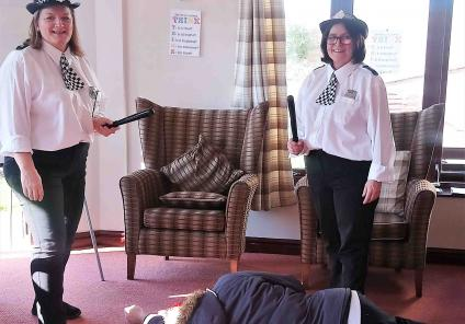 Crabwall Hall Care Home in Chester had their very own murder mystery where residents identified evidence and solved the clues. Magic Moments Club Co-ordinators Karen and Carolyn are dressed as WPCs with Chef Ian as the corpse!