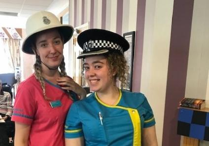 Silver Springs Care Home in Jersey had fun with their police-themed day which included quizzes and a visit from the Jersey State Police, followed by mystery wine and cheese. Magic Moments Club Co-ordinator Katie and Carer Sophie try on the police hats!