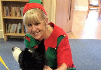 Our elf a.k.a. receptionist Bev loving Jack the therapy dog's Christmas outfit