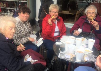 Lawton Manor Care Home, Staffordshire-Enjoying our chips al fresco. Resident Ann, Magic Moments Club Assistant Liz, volunteer and former team member Ann and resident Alice