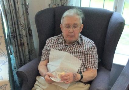 Lawton Manor Care Home, Staffordshire-Resident Patrick deciding which cake to go for next!