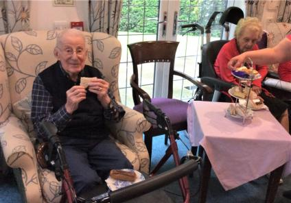 Lawton Manor Care Home, Staffordshire-Residents Roy and Ann enjoying afternoon tea after a busy gardening session
