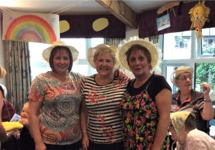 Lawton Manor Care Home, Staffordshire-Team member Debbie, retired team member Ann and team member Yvonne sporting their stripey socks!
