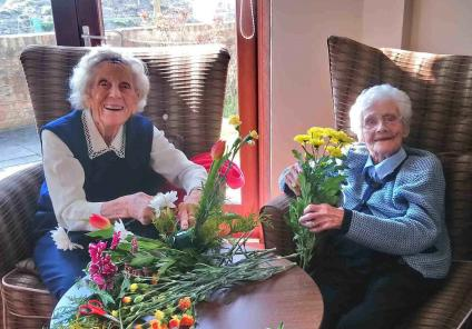 Residents celebrating Mother's Day with fabulous floristry at Crabwall Hall Care Home in Chester