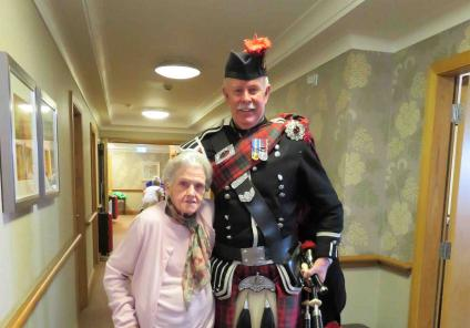 Westbury Court Care Home had a special performance from bagpipe player  Bob MacNaught. Here he is with resident Marjorie
